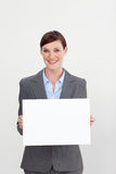 Confident businesswoman holding white card Stock Images