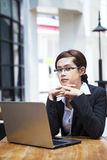 Confident businesswoman and laptop Stock Photography