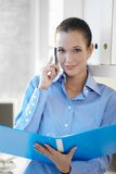 Confident businesswoman looking at document Royalty Free Stock Images