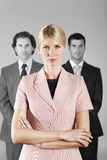 Confident Businesswoman With Male Colleagues In Background Royalty Free Stock Photo
