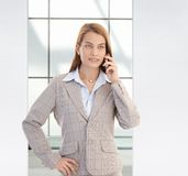 Confident businesswoman on mobile smiling Stock Photo