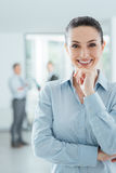 Confident businesswoman in the office posing Stock Images