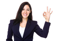 Confident businesswoman with ok sign gesture Stock Photos