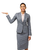 Confident Businesswoman Presenting Invisible Product Stock Photography