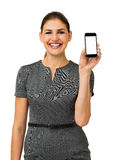 Confident Businesswoman Promoting Smart Phone Royalty Free Stock Photo