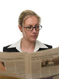 Confident businesswoman reading a newspaper Stock Photo