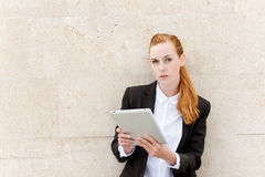 Confident Businesswoman Reading Tablet PC Royalty Free Stock Photos
