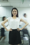 Confident Businesswoman with Rushing Colleagues Behind Her Royalty Free Stock Photography