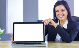 Confident businesswoman showing her laptop Stock Photography