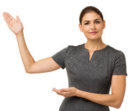Confident Businesswoman Showing An Imaginary Product. Portrait of confident businesswoman showing an imaginary product isolated over white background. Horizontal Stock Photography