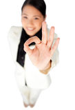 Confident businesswoman showing OK sign Stock Photography