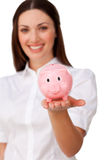 Confident businesswoman showing a piggybank Royalty Free Stock Photos