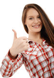 Confident businesswoman showing thumbs up Stock Photos