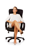 Confident businesswoman sitting on armchair Royalty Free Stock Image