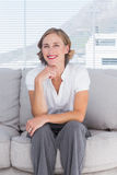 Confident businesswoman sitting on couch Stock Images