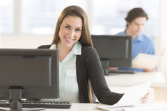 Confident Businesswoman Sitting At Desk Royalty Free Stock Photo