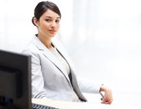 Confident businesswoman sitting in her office Stock Photography