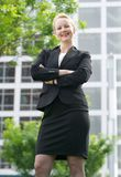 Confident businesswoman smiling outdoors Stock Photos