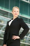 Confident businesswoman smiling outside office bui Royalty Free Stock Images