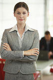 Confident Businesswoman Standing Arms Crossed In Office Stock Photo