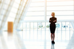 Confident businesswoman is standing in bought empty office space while is thinking about furnishings. Royalty Free Stock Photography
