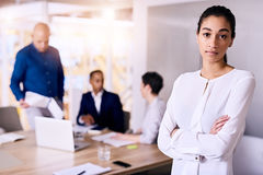 Confident businesswoman standing in front of her team arms crossed Royalty Free Stock Images