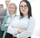 Confident businesswoman standing in front of his business team royalty free stock photo