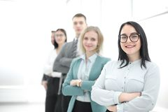 Confident businesswoman standing in front of his business team. Photo with copy space stock photo