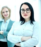 Confident businesswoman standing in front of his business team stock photography