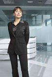 Confident Businesswoman Standing In Office Stock Images