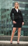 Confident businesswoman standing outside building Royalty Free Stock Photos
