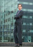 Confident businesswoman standing outside the office Stock Photos
