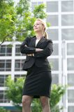 Confident businesswoman standing outside the office Stock Images
