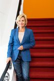 Confident Businesswoman Standing On Steps Stock Photos