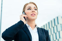 Confident businesswoman talking on business phone Royalty Free Stock Images