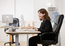 Confident businesswoman talking on headset Royalty Free Stock Photos