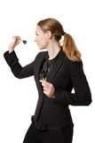 Confident businesswoman throwing dart Royalty Free Stock Photos