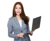 Confident businesswoman use of the laptop computer Royalty Free Stock Image