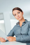 Confident businesswoman using a digital tablet Royalty Free Stock Photography