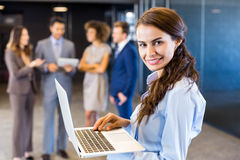 Confident businesswoman using laptop in office Royalty Free Stock Image