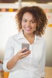 Confident businesswoman using phone Stock Image