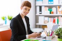 Confident businesswoman using a smart phone Stock Photo
