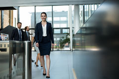 Confident businesswoman walking in office Stock Image