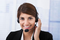 Confident Businesswoman Wearing Headset In Office Stock Images