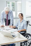 Confident businesswoman in wheelchair royalty free stock photo