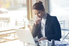 Confident businesswoman working on a laptop Stock Image
