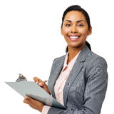 Confident Businesswoman Writing On Clipboard Stock Images