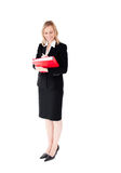 Confident businesswoman writing on a folder Stock Photo