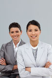 Confident businesswomen with folded arms standing Royalty Free Stock Photos