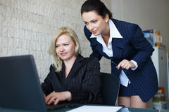 Confident businesswomen team communicate by laptop Stock Photography